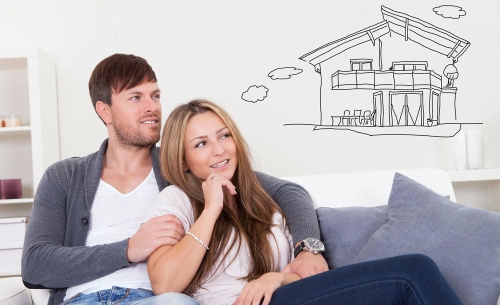 Paar plant Eigenheim - Kager Bau hilft auch Ihnen dabei